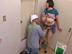 Mature Asian with huge tits gives a blowjob to a horny man